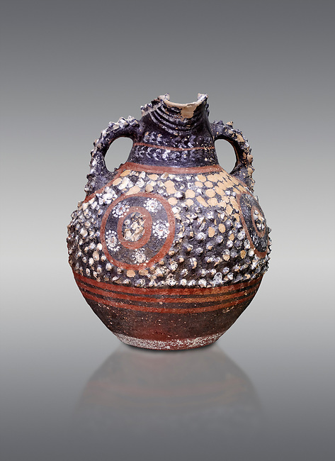 Minoan Kamares Ware with polychrome decorations on a rough prickly surface, Poros-Heraklion 1900-1700 BC; Heraklion Archaeological  Museum, grey background.<br /> <br /> This style of pottery is named afetr Kamares cave where this style of pottery was first found