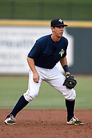 Third baseman Colby Woodmansee (26) of the Columbia Fireflies plays defense in a game against the Charleston RiverDogs on Monday, August 7, 2017, at Spirit Communications Park in Columbia, South Carolina. Columbia won, 6-4. (Tom Priddy/Four Seam Images)