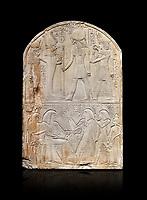 Ancient Egyptian stele dedicated to the god Re-Harakhty by sculptor Ipy, limestone, New Kingdom, 19th Dynasty, (1279-1213 BC), Deir el-Medina, Drovetti cat 7357. Egyptian Museum, Turin. black background,