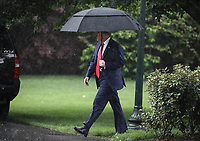 United States President Donald J. Trump walks on the South Lawn of the White House in a heavy rain before boarding Marine One on June 11, 2020 in Washington, DC., for a trip to Dallas, Texas.<br /> Credit: Oliver Contreras / Pool via CNP/AdMedia