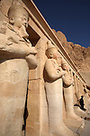 The stone statues of Hatshepsut Temple with an armed guard in the background. Luxor. Egypt