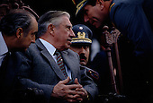 "Talca, Chile.September 23, 1988..General Augusto Pinochet and his advisors...In October 1988, General Pinochet ordered a plebiscite vote asking Chilean citizens whether he should continue in office. It produced a decisive ""no"" vote and the following year he lost the first presidential election in 19 years. However, under a constitution crafted by his advisors, he remained as army commander until 1998. Pinochet continued to wield enormous power until his arrest in London on human rights charges in October 1998."