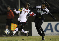 COLLEGE PARK, MD - NOVEMBER 25, 2012: Mikias Eticha (11) of the University of Maryland gets the ball away from Mikey Lightbourne (17) of Coastal Carolina University during an NCAA championship third round match at Ludwig Field, in College Park, MD, on November 25. Maryland won 5-1.