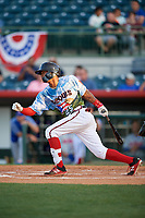 Florida Fire Frogs center fielder Cristian Pache (25) follows through on a swing during a game against the St. Lucie Mets on April 19, 2018 at Osceola County Stadium in Kissimmee, Florida.  St. Lucie defeated Florida 3-2.  (Mike Janes/Four Seam Images)