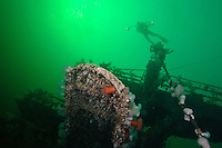 Scuba Diver explores the wreck of the HCMS Saskatchewan beneath the waters of the Strait of Georgia, off Nanaimo, British Columbia, Canada.