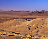 Morning in the Sinai desert near Eilat, with roadwas and tracks across near dunes, low hills behind; Israe