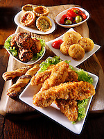 Party buffet food with southern fried chicken, bhajis, mini quiche and deep fried camembert