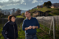 """Switzerland. Canton Ticino. Cagiallo. Merlot wineyard """"Ronco della Plana"""". Two winemakers Valentina Andrei (L) and Sacha Pelossi (R). The Swiss rock band Gotthard is associated with winemakers Valentina Andrei (Merlot Ivresse from Valais) and Sacha Pelossi (Merlot from Ticino) to create the new vintage bottle: Magnificents' 17. Cagiallo is a village and and is part of the Capriasca municipality. 25.03.2019 © 2019 Didier Ruef"""