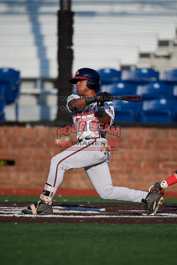 Danville Braves center fielder Justin Dean (13) follows through on a swing during a game against the Johnson City Cardinals on July 29, 2018 at TVA Credit Union Ballpark in Johnson City, Tennessee.  Johnson City defeated Danville 8-1.  (Mike Janes/Four Seam Images)