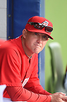 Potomac Nationals manager Tripp Keister (6) in the dugout before a game against the Lynchburg Hillcats on April 26, 2014 at Pfitzner Stadium in Woodbridge, Virginia.  Potomac defeated Lynchburg 6-2.  (Mike Janes/Four Seam Images)