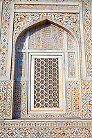 """Agra, India.   Geometric Window Design, with Pietra Dura Stone Work.  Itimad-ud-Dawlah, Mausoleum of Mirza Ghiyas Beg.  The tomb is sometimes referred to as the """"Baby Taj.""""  It is one of the finest examples of pietra dura work, making designs through the use of inlaid colored stone."""