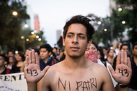 Protest in Mexico City. Thousands march from downtown Mexico City to the Angel monument of Independence. People demands from the government to explain what happened to the 43 students that went missing on Sept. 26, 2014 from Raul Isidro Burgos Rural teachers college of Ayotzinapa in Iguala Guerrero. This day marks two years since president Peña Nieto took power on Dec. 1st 2012. Mexico City, Mexico. Dec 01, 2014.