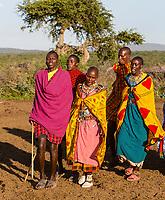 Tanzania. Maasai Village of Ololosokwan, Northern Serengeti.  Villagers Performing Welcoming Dance.