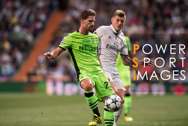 Toni Kroos of Real Madrid fights for the ball with Adrien Silva of Sporting Portugal during their 2016-17 UEFA Champions League match between Real Madrid vs Sporting Portugal at the Santiago Bernabeu Stadium on 14 September 2016 in Madrid, Spain. Photo by Diego Gonzalez Souto / Power Sport Images
