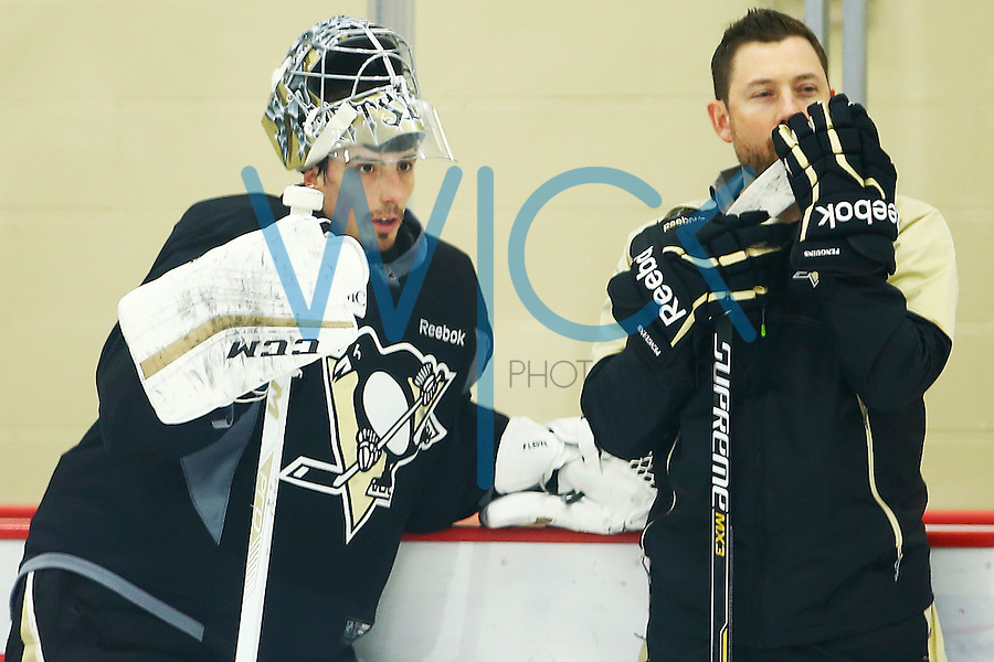 Marc-Andre Fleury #29 of the Pittsburgh Penguins talks with goaltending coach Mike Bales during practice at UPMC Lemieux Sports Complex in Cranberry Township, Pennsylvania on April 26, 2016. (Photo by Jared Wickerham / DKPS)