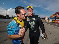 Sep 25, 2016; Madison, IL, USA; NHRA pro stock driver Alex Laughlin (right) celebrates after winning the Midwest Nationals at Gateway Motorsports Park. Mandatory Credit: Mark J. Rebilas-USA TODAY Sports