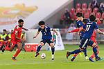 Minamino Takumi of Japan (C) is tackled by Harib Al Saadi of Oman (L) during the AFC Asian Cup UAE 2019 Group F match between Oman (OMA) and Japan (JPN) at Zayed Sports City Stadium on 13 January 2019 in Abu Dhabi, United Arab Emirates. Photo by Marcio Rodrigo Machado / Power Sport Images