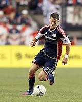 New England Revolution forward Blake Brettschneider (23) brings the ball forward. In a Major League Soccer (MLS) match, the New England Revolution tied Houston Dynamo, 2-2, at Gillette Stadium on May 19, 2012.