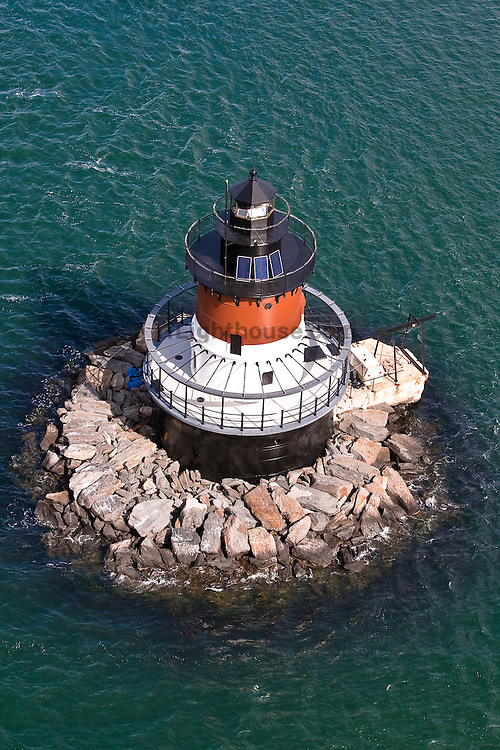 An aerial view of the Plum Beach lighthouse next to the Jamestown Bridge on the North Kingstown, R.I. side.