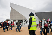 A security guard employed by private contractor Sword on duty outside the Aquatic Centre in the London 2012 Olympic Park.