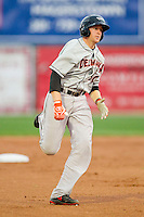 Wynston Sawyer (30) of the Delmarva Shorebirds legs out a triple against the Hagerstown Suns at Municipal Stadium on April 11, 2013 in Hagerstown, Maryland.  The Shorebirds defeated the Suns 7-4 in 10 innings.  (Brian Westerholt/Four Seam Images)