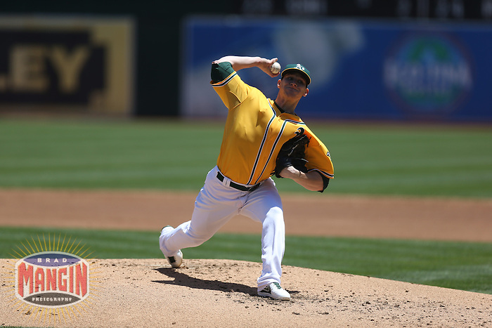 OAKLAND, CA - JUNE 13:  Jarrod Parker #11 of the Oakland Athletics pitches against the New York Yankees during the game at O.co Coliseum on Thursday June 13, 2013 in Oakland, California. Photo by Brad Mangin