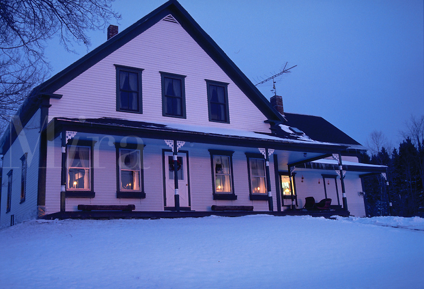 Winter scene of a house in the country. New Hampshire.