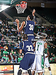 Florida International University Panthers forward Dominique Ferguson (33) gets a basket while Florida International University Panthers guard Jeremy Allen (32) blocks out North Texas Mean Green guard Dominique Johnson (1) in the NCAA  basketball game between the Florida International University Panthers and the University of North Texas Mean Green at the North Texas Coliseum,the Super Pit, in Denton, Texas. UNT defeated FIU 87 to 77