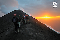 Hikers walking on ridge of Stromboli volcano with fumaroles at sunset (Licence this image exclusively with Getty: http://www.gettyimages.com/detail/sb10069713j-001 )