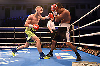 Frank Arnold (blue shorts) defeats Jose Aguilar during a Boxing Show at York Hall on 9th November 2019