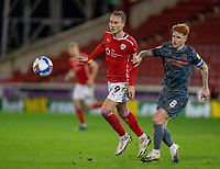 21st November 2020, Oakwell Stadium, Barnsley, Yorkshire, England; English Football League Championship Football, Barnsley FC versus Nottingham Forest; Cauley Woodrow of Barnsley and Jack Colback of Nottingham Forrest chase the loose ball