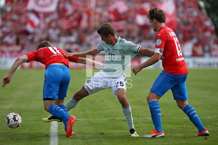 18.08.2018, Football DFB Pokal 2018/2019, 1. round, SV Drochtersen Assel - FC Bayern Muenchen, Kehdinger stadium Drochtersen.  Jasper Goossen (SV Drochtersen-Assel)  -  and Thomas Mueller (Bayern Muenchen) and Soeren Behrmann (SV Drochtersen-Assel)<br /><br /><br />***DFB rules prohibit use in MMS Services via handheld devices until two hours after a match and any usage on internet or online media simulating video foodaye during the match.*** *** Local Caption *** © pixathlon<br /> <br /> Contact: +49-40-22 63 02 60 , info@pixathlon.de