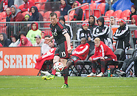 Toronto, Ontario - May 3, 2014: Toronto FC defender Steven Caldwell #13 in action during a game between the New England Revolution and Toronto FC at BMO Field.<br /> The New England Revolution won 2-1.