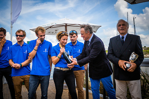Corinne Migraine and Father Gilles Fournier collect prizes from RORC's Michael Boyd for Pintia's IRC Two victory in the 2017 Rolex Fastnet Race Photo: ELWJ Photos/RORC