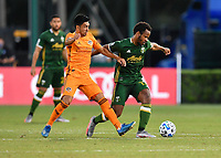LAKE BUENA VISTA, FL - JULY 18: Jeremy Ebobisse #17 of the Portland Timbers dribbles away from Memo Rodríguez #8 of the Houston Dynamo during a game between Houston Dynamo and Portland Timbers at ESPN Wide World of Sports on July 18, 2020 in Lake Buena Vista, Florida.