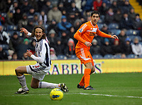 Pictured: Danny Graham of Swansea (R) and Jonas Olsson of West Bromwich (L). Saturday, 04 February 2012<br /> Re: Premier League football, West Bromwich Albion v Swansea City FC v at the Hawthorns Stadium, Birmingham, West Midlands.