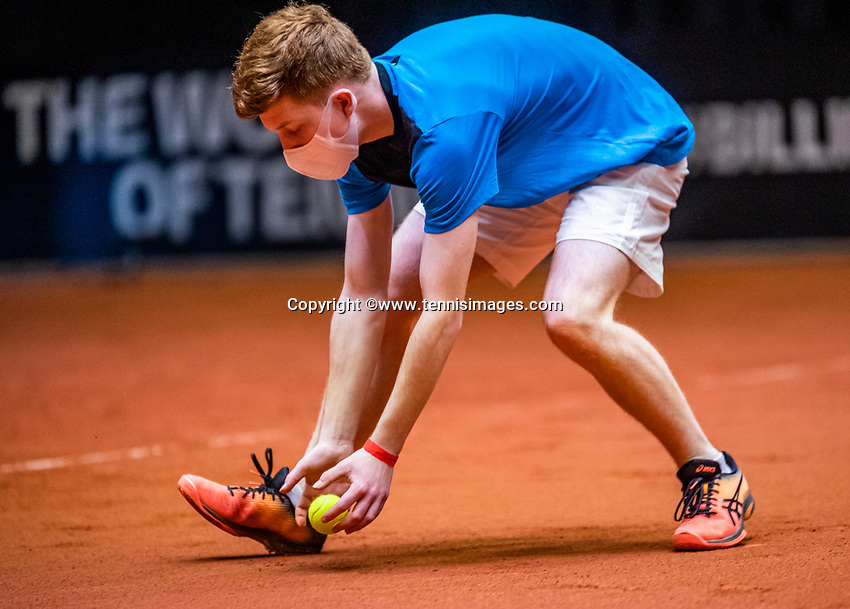 Den Bosch, The Netherlands, April 16, 2021,    Maaspoort, Billy Jean King Cup  Netherlands -  China , seccond day first match: ballboy with facemask<br /> Photo: Tennisimages/Henk Koster