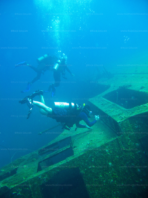 "Diving Bonaire, Netherland Antilles -- Divers explore the wreck of the Hilma Hooker.  (""Hilma Hooker"" dive site)."