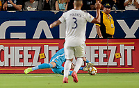 CARSON, CA - SEPTEMBER 21: David Bingham #1 of the Los Angeles Galaxy dives for a ball during a game between Montreal Impact and Los Angeles Galaxy at Dignity Health Sports Park on September 21, 2019 in Carson, California.