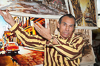 Cuba, Havana.  Artist Saul Fidel Teranzo Castro Offering his Paintings for Sale, Artisans Market.