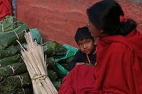 Child and Mother, Street vendor at Durbar Square and old Town Area in Kathmandu