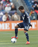 Sporting Kansas City midfielder Benny Feilhaber (10) controls the ball at midfield.   In a Major League Soccer (MLS) match, Sporting Kansas City (blue) tied the New England Revolution (white), 0-0, at Gillette Stadium on March 23, 2013.