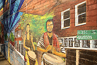 NoDa Neighborhood<br /> <br /> NoDa- Charlotte Historic Arts District, located in North Charlotte neighborhood in the North Davidson and 36th Street.<br /> <br /> Colorful artwork on the walls of many building in the NoDa neighborhood, creates plenty to look at as people make their way through the streets of the historic neighborhood.<br /> <br /> Charlotte Photographer - PatrickSchneiderPhoto.com