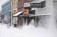 Bentonville Public Works crew members blow snow from the sidewalks, Monday, February 15, 2021 on Main Street near the Square in Bentonville. Check out nwaonline.com/210216Daily/ for today's photo gallery. <br /> (NWA Democrat-Gazette/Charlie Kaijo)