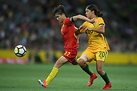 22 November 2017, Melbourne - MA JUN (32) of China PR and SAM KERR (20) of Australia compete for the ball during an international friendly match between the Australian Matildas and China PR at AAMI Stadium in Melbourne, Australia.. Australia won 5-1. Photo Sydney Low