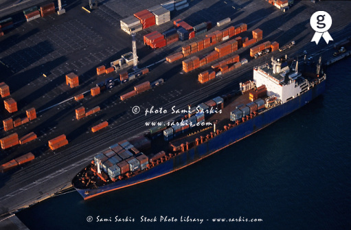 Cargo at quay loading freight container at port, aerial view (Licence this image exclusively with Getty: http://www.gettyimages.com/detail/sb10066434a-001 )