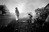 Krasny Yar, Siberia, Russia, 1995<br /> <br /> Krasny Yar is a village which can only be accessed by water and is only inhabited by the indigenous Udege people. This couple milks a cow under the smoke of a fire to avoid the massive bug culture that exists there.