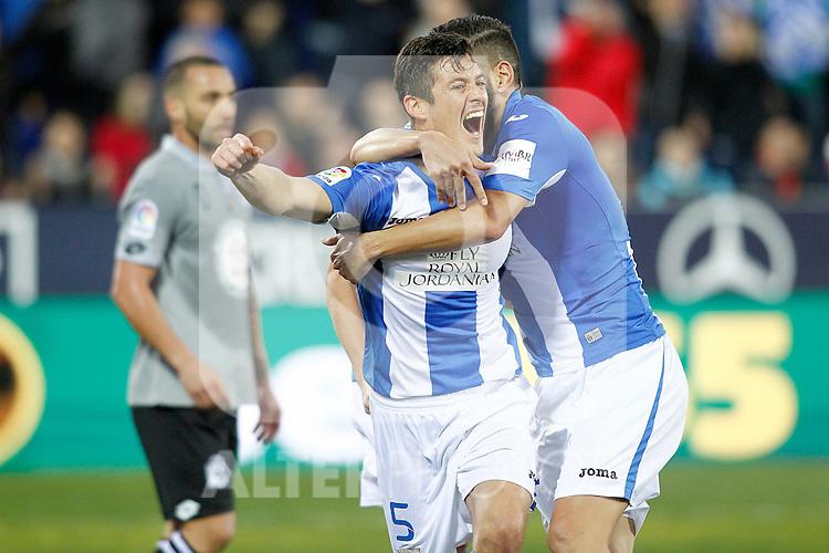 CD Leganes' Martin Mantovani and Dimitrios Siovas celebrate goal in presence of Deportivo de la Coruna's Guilherme Dos Santos dejected during La Liga match. February 25,2017. (ALTERPHOTOS/Acero)
