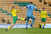 9th January 2021; Carrow Road, Norwich, Norfolk, England, English FA Cup Football, Norwich versus Coventry City; A high challenge from Todd Cantwell of Norwich City on Kyle McFadzean of Coventry City