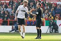 Oli McBurnie of Swansea City protests to referee Jeremy Simpson after being shown a yellow card during the Sky Bet Championship match between Nottingham Forest and Swansea City at City Ground, Nottingham, England, UK. Saturday 30 March 2019